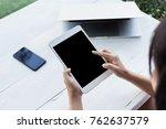 hand holding digital tablet... | Shutterstock . vector #762637579
