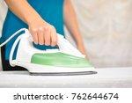 closeup of woman ironing...   Shutterstock . vector #762644674