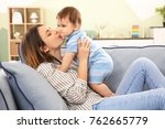 mother with baby boy on sofa at ... | Shutterstock . vector #762665779