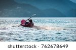 kayaking with splashes on red... | Shutterstock . vector #762678649