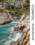 """Small photo of View of the bay """"Calanques Sugiton"""" near Marseille in South France on a stormy Mistral day"""