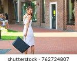 happy elegant woman walking... | Shutterstock . vector #762724807