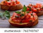 closeup bruschetta with cherry... | Shutterstock . vector #762743767