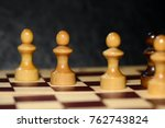chess figures on a chessboard... | Shutterstock . vector #762743824