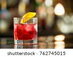 closeup glass of red negroni... | Shutterstock . vector #762745015