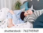 sick woman is lying in bed with ... | Shutterstock . vector #762745969
