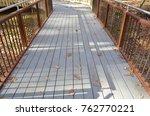 grey composite wood walkway or... | Shutterstock . vector #762770221