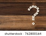 Stock photo question mark tiles arranged forming bigger question mark question mark on wooden table background 762800164