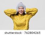surprised woman winter portrait.... | Shutterstock . vector #762804265