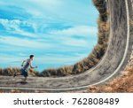 athlete running on a bend road. | Shutterstock . vector #762808489