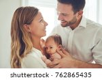 smiling young mother and father ... | Shutterstock . vector #762865435