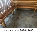 long wooden chairs and marble