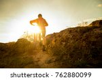 cyclist in red picking his... | Shutterstock . vector #762880099