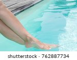 woman legs in a swimming pool | Shutterstock . vector #762887734
