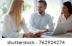business colleagues laughing | Shutterstock . vector #762924274