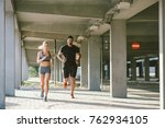 athlete couple running at the... | Shutterstock . vector #762934105