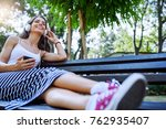 beautiful young woman sitting... | Shutterstock . vector #762935407