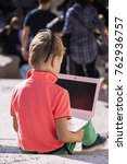 boy looks at a laptop on the... | Shutterstock . vector #762936757