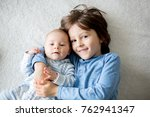 happy brothers  baby and... | Shutterstock . vector #762941347