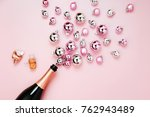 champagne bottle with pink and... | Shutterstock . vector #762943489