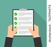 the paper checklist in the hand.... | Shutterstock .eps vector #762994474