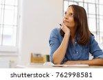 businesswoman sitting thinking... | Shutterstock . vector #762998581