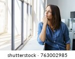thoughtful woman staring out of ... | Shutterstock . vector #763002985