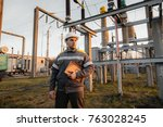 the energy engineer inspects... | Shutterstock . vector #763028245
