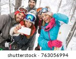 smiling male with female skiers ... | Shutterstock . vector #763056994
