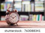 retro alarm clock on a wooden... | Shutterstock . vector #763088341