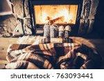 feet in woollen socks by the... | Shutterstock . vector #763093441