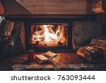 Open Book By The Fireplace With ...
