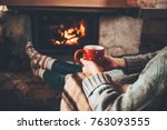 feet in woollen socks by the... | Shutterstock . vector #763093555