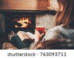 woman in woollen socks by the... | Shutterstock . vector #763093711