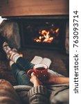 feet in woollen socks by the... | Shutterstock . vector #763093714