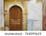 wooden door to the house in... | Shutterstock . vector #763095625