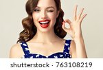 pin up retro girl with curly... | Shutterstock . vector #763108219