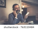 senior old man listening to his ... | Shutterstock . vector #763110484