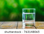 a glass of water on green... | Shutterstock . vector #763148065