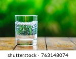 a glass of water on green... | Shutterstock . vector #763148074