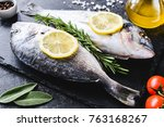 fresh sea fish with olive oil ... | Shutterstock . vector #763168267