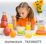 little girl eating cornflakes... | Shutterstock . vector #763186075