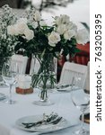 wedding table decorated with...   Shutterstock . vector #763205395