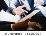 business partners discussing... | Shutterstock . vector #763207024