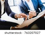 business partners discussing... | Shutterstock . vector #763207027