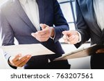 business partners discussing... | Shutterstock . vector #763207561