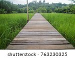 wooden walk way through paddy... | Shutterstock . vector #763230325