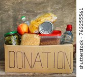donation box with food.  | Shutterstock . vector #763255561