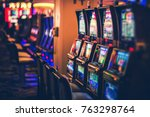 Rows of Casino Slot Machines with Shallow Depth of Field. Las Vegas Gambling Theme. - stock photo