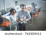 colleagues standing in office... | Shutterstock . vector #763303411